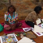 Two Aboriginal women selling their own paintings