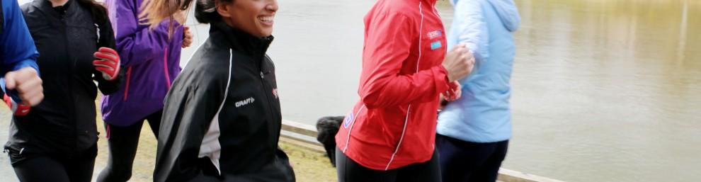 Four women running by Nidelven in Trondheim