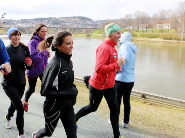 Four women running by Nidelven in Trondheim