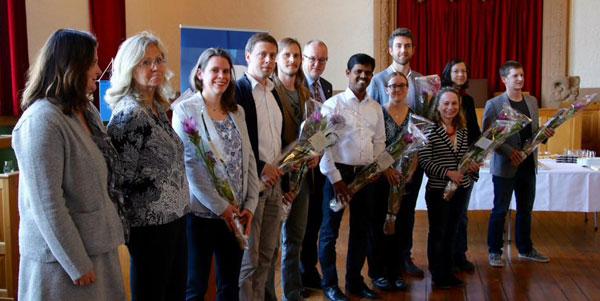 The 12 Onsager Fellowship holders with Rector Gunnar Bovim. Photo: Morten Thoresen / NTNU