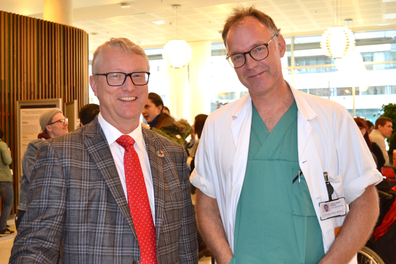 "From the left; Professor Thorkild Tylleskär, here with Dr. Håkon Angell Bolkan that have been supervising some of the research that was presented in the ""poster walk""."