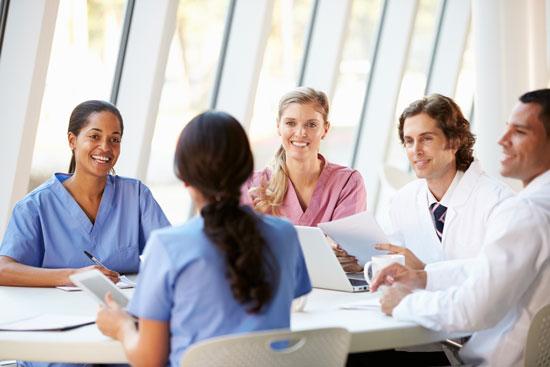 medical team meeting around table