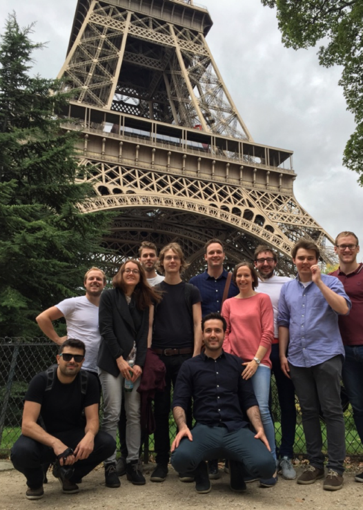 A Group of researchers in fromt of the Eiffel Tower in Paris